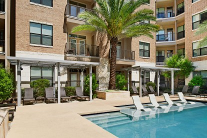 Poolside cabanas and in water lounge chairs