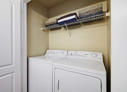 Laundry with side by side washer dryer and shelf
