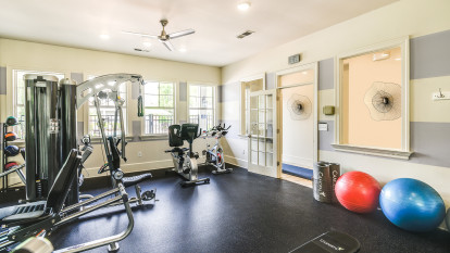 Fitness center with strength training equipment at Camden Governors Village Apartments in Chapel Hill, NC