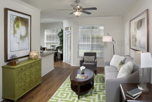 Living room with large windows and ceiling fan