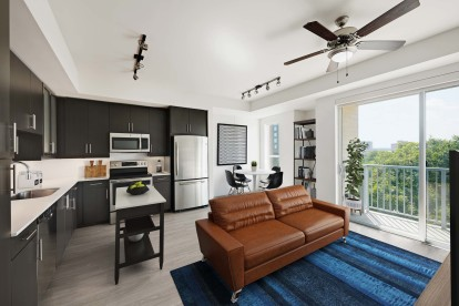 Open concept living dining and kitchen with sliding glass doors to balcony and wood look floors