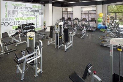 24-Hour Fitness Center with a wide array of cardio and strength training equipment