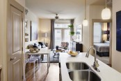 Open concept living room kitchen with double sink