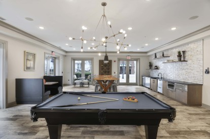 Resident lounge with pool table and entertaining kitchen