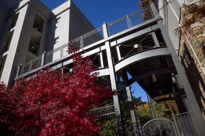 Outdoor walkway from covered parking garage to midrise apartments