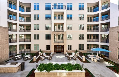 Outdoor center courtyard with lounge areas and grills