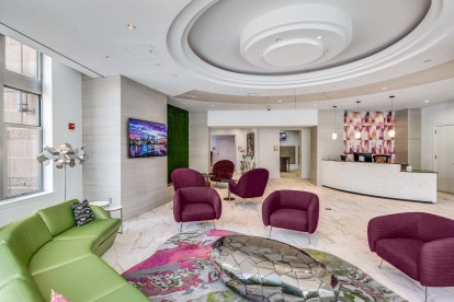 Concierge lobby with purple chairs