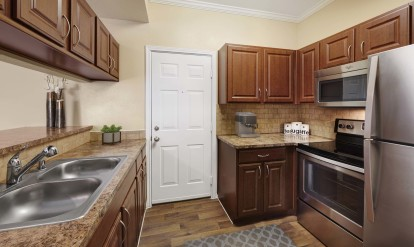 Kitchen with bar countertop and stainless steel appliances