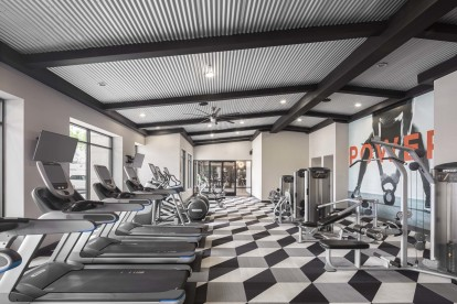 24 hour fitness center with treadmills and strength training equipment