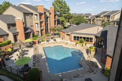 Aerial view of pool with sundeck and outdoor dining areas
