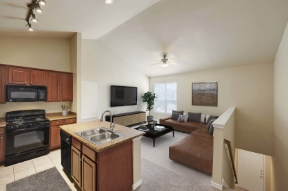 Kitchen opens to large living room