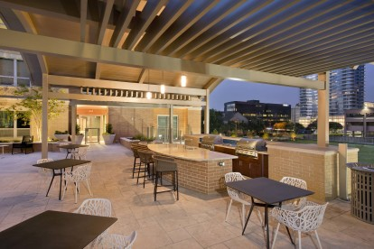 Outdoor kitchen with barbeques and dining areas