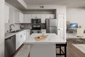 Townhome kitchen island stainless steel appliances near home office