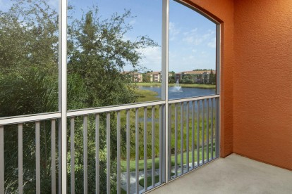Balcony overlooking lake with water feature