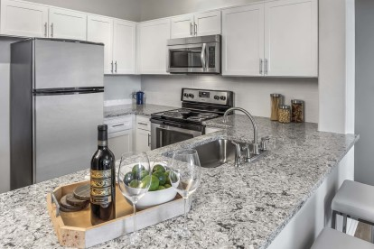 Kitchen with quartz countertops and white cabinets