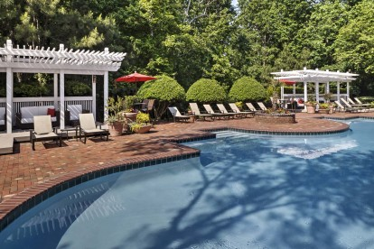 Outdoor resort style pool with lounge chairs