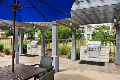 Outdoor dining and grills under covered patio