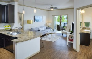 Open concept kitchen living room with wood inspired flooring