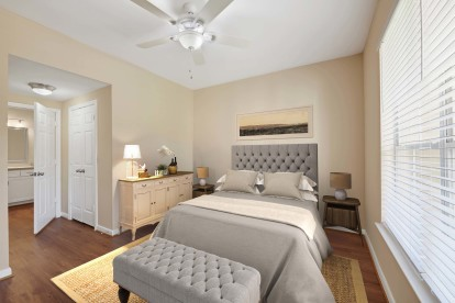 Neighborhood one bedroom with wood look floring ensuite bath and ceiling fan with light