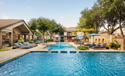 Resort style pool with lounge seating
