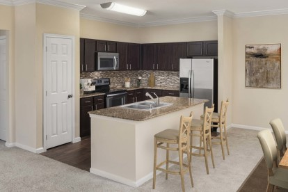 Vista style kitchen with granite countertops crown molding and stainless steel appliances