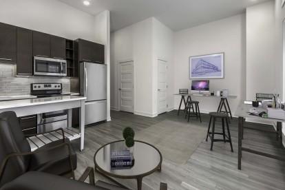 Live work apartment living room with desks
