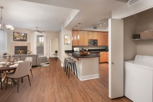 Open concept floor plan with living dining and kitchen with wood style flooring