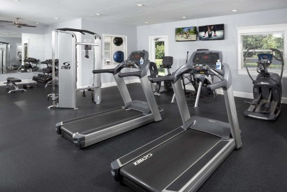 Fitness center with free weights circuit training cardio equipment and yoga studio