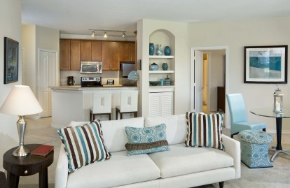 Open-concept kitchen and living room with built-in bookshelves and extra flex space