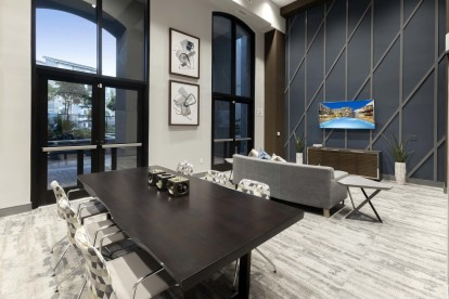 Lounge area with tv and dining table