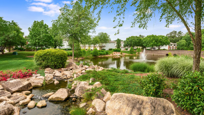 Picturesque lake alongside community at Camden Governors Village Apartments in Chapel Hill, NC