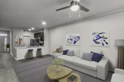 Townhome floor plan living room with crown molding wood look flooring and ceiling fan