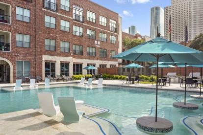 Midtown pool with umbrellas