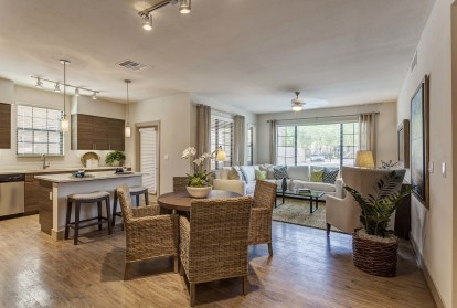 Open concept dining area near kitchen island and sunny living room