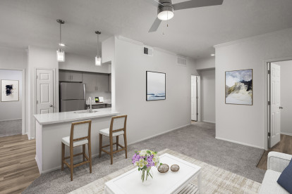 Open-concept living room near kitchen with room for barstool seating