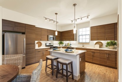 Kitchen with stainless steel appliances barstool seating and dining area