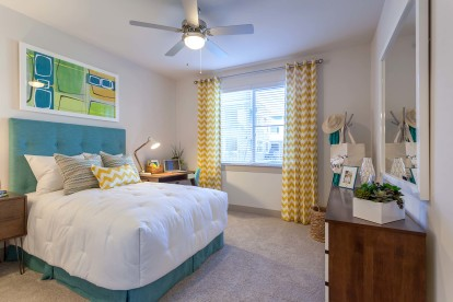 Bedroom with lighted ceiling fan and space for a home office