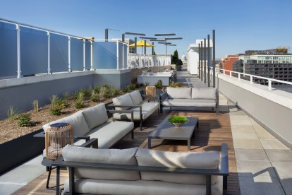 Rooftop entertainment lounge with grill stations