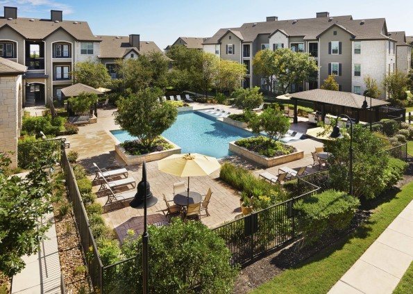 Pool with expansive sundeck outdoor dining and barbeques