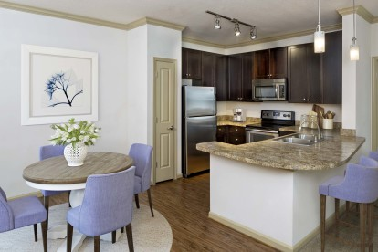 Dining room and kitchen with pantry and energy efficient stainless appliances