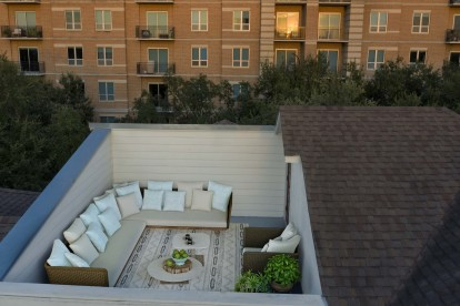 The townhomes rooftop terrace with dining and seating space