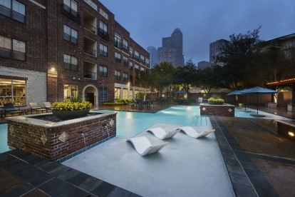 Midtown pool at dusk with downtown houston views