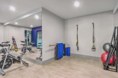 Yoga room with TRX training and spin bikes