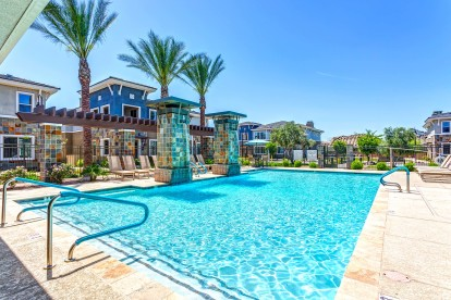 Large resort style pool with lounge and seating areas