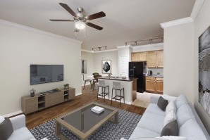 Open concept living room with wood look and tile floor ceiling fan track lighting and crown molding