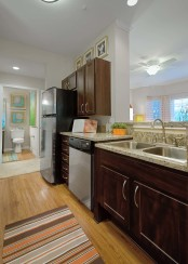 Traditional style kitchen with granite style countertops and wood look flooring