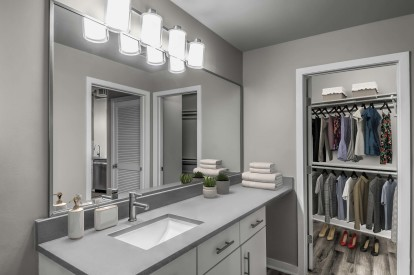 Contemporary midrise apartment bathroom with single sink and walk in closet