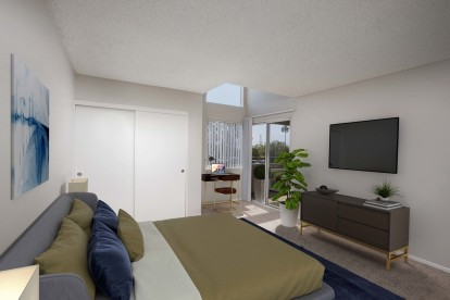 Bedroom with home office nook and access to private balcony through sliding glass doors