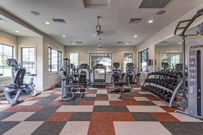 Fitness center with weight machines and cardio equipment