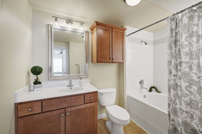 Bathroom with bathtub with tile surround and straight shower rod